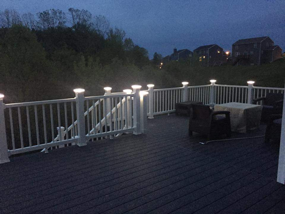 deck build with lighted posts at night